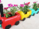 Recycle Plastic Bottles Into Colorful Train-Shaped Flower Pots For Small Gardens And Balconies