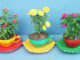 Reuse Plastic Bottles And Bottle Caps To Make A Stunning Tea Cup-Shaped Plant Pot