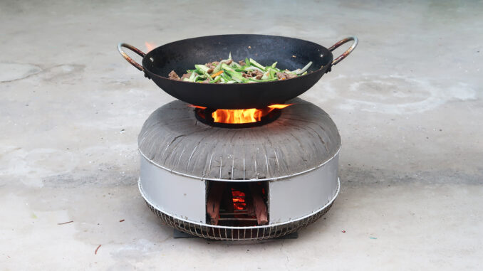 DIY wood stove from fan shield and cement